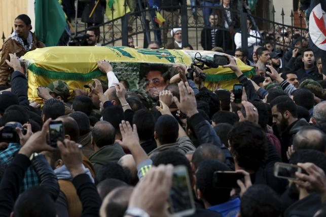 Relatives and supporters carry the coffin of Lebanese Hezbollah militant leader Samir Qantar during his funeral in Beirut's southern suburbs