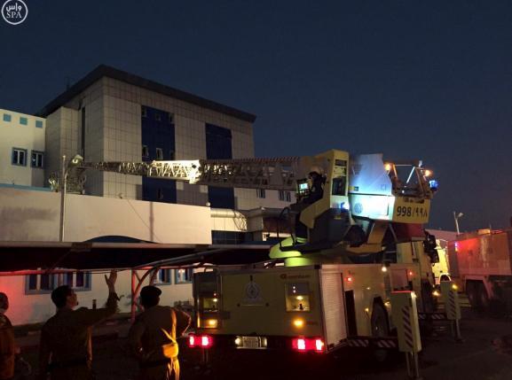 Members of Saudi Civil Defence work at Jazan General Hospital following pre-dawn fire in the port city of Jazan