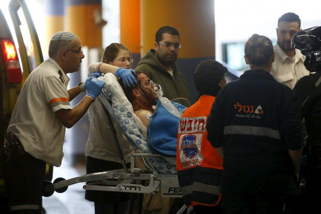 Israeli medics evacuate an Israeli man, injured by what Israeli military's initial report said was a Palestinian stabbing attack in the West Bank, at a hospital in Jerusalem