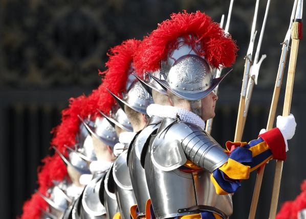 "Swiss Guards stand before Pope Francis delivered ""Urbi et Orbi"" message from balcony overlooking St. Peter's Square at the Vatican"