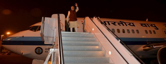 Indian Prime Minister Narendra Modi waves from the plane after meeting with his Pakistani counterpart Nawaz Sharif in Lahore