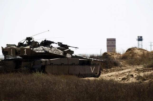 An Israeli army tank takes position along Israel's border with Egypt
