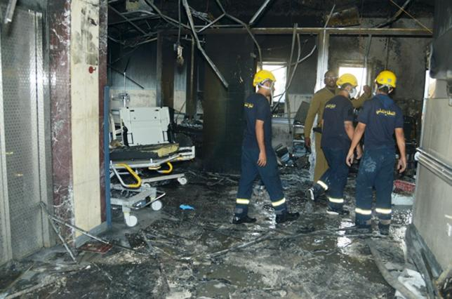 Members of Saudi Civil Defence inspect the damage at Jazan General Hospital following a pre-dawn fire in the port city of Jazan,