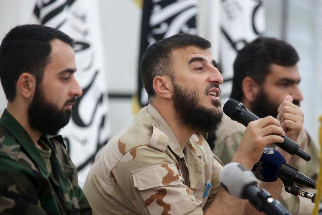 Zahran Alloush, commander of Jaysh al Islam, talks during a conference in the town of Douma, eastern Ghouta in Damascus