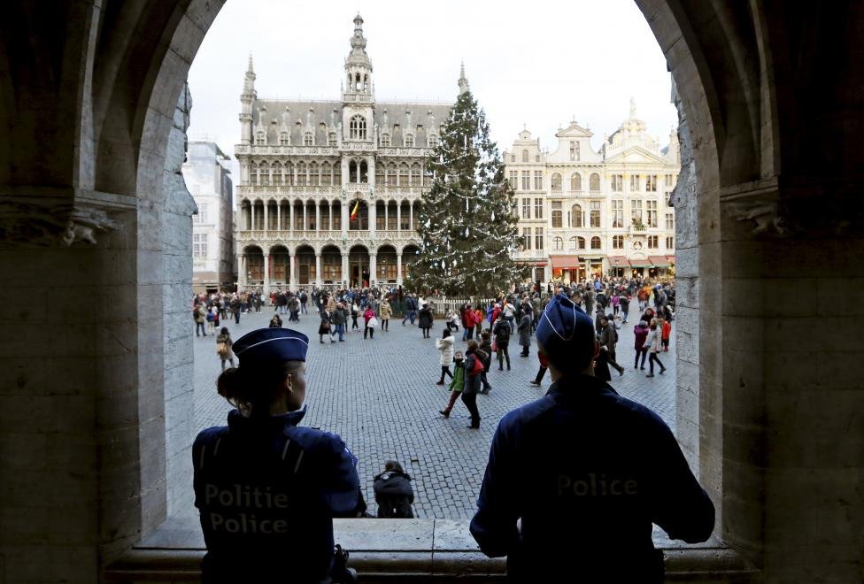 Belgian police officers stand guard on Brussels' Grand Place