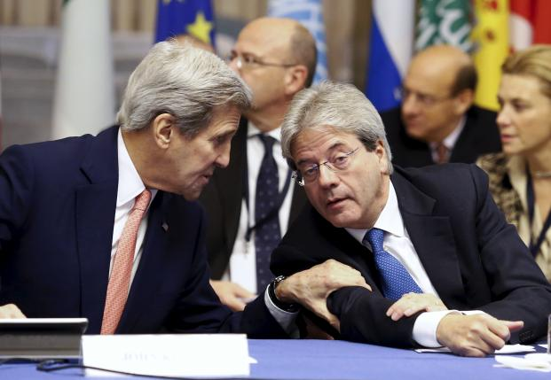 U.S. Secretary of State Kerry and Italian Foreign Minister Gentiloni talk during a meeting in Rome