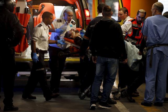 Israeli medics evacuate an Israeli man to Sha'are Zedek hospital in Jerusalem