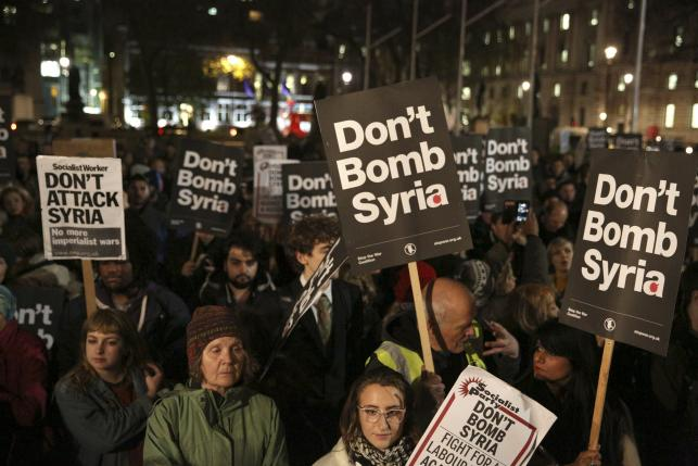 Anti-war protesters demonstrate against proposals to bomb Syria outside the Houses of Parliament in London, Britain