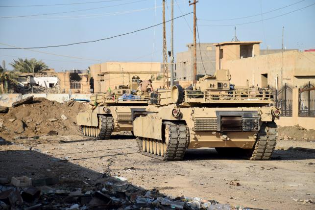 Tanks are seen in the city of Ramadi
