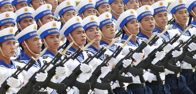 Sailors hold Israeli-made Galil riffles while marching during a celebration to mark National Day at Ba Dinh square in Hanoi