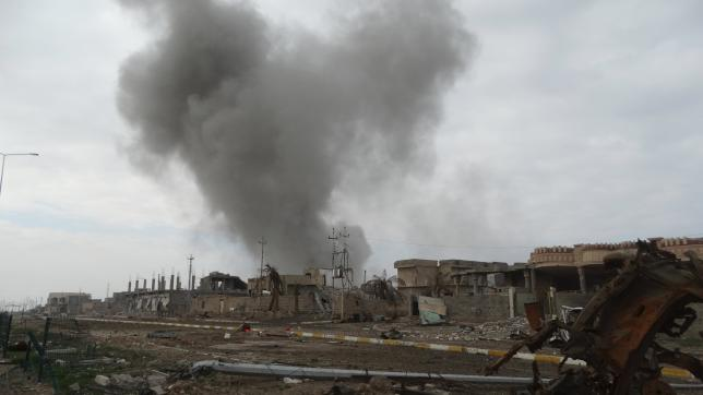 Smoke rises above a building during an air strike in Ramadi city