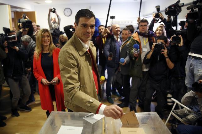 Spain's Socialist Party (PSOE) leader Pedro Sanchez casts his vote in Spain's general election in Pozuelo de Alarcon, near Madrid