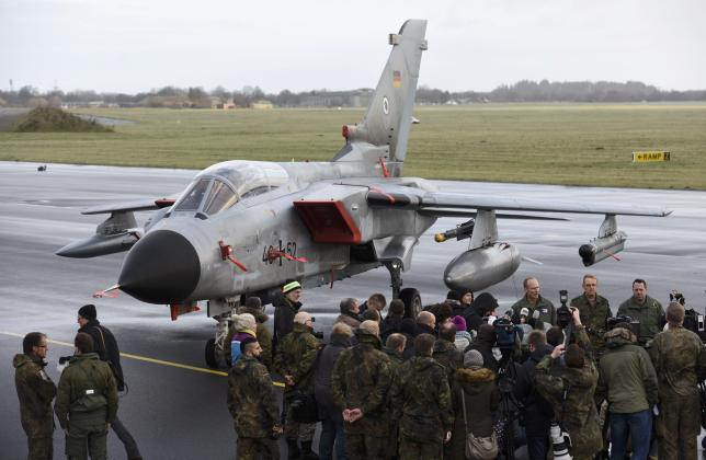 Journalists stand in front of a Tornado aircraft of the Tactical Air Force Wing 51 'Immelmann' during a presentation at German army Bundeswehr airbase in Jagel near the German-Danish border
