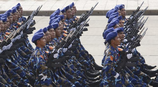 Marine patrol servicemen hold Israeli-made Galil riffles while marching during a celebration to mark National Day at Ba Dinh square in Hanoi