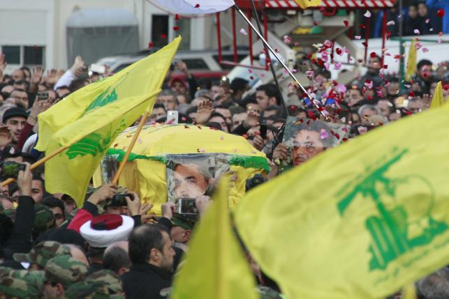 Hezbollah members carry the coffin of Hezbollah militant leader Samir Qantar during his funeral in Beirut's southern suburbs