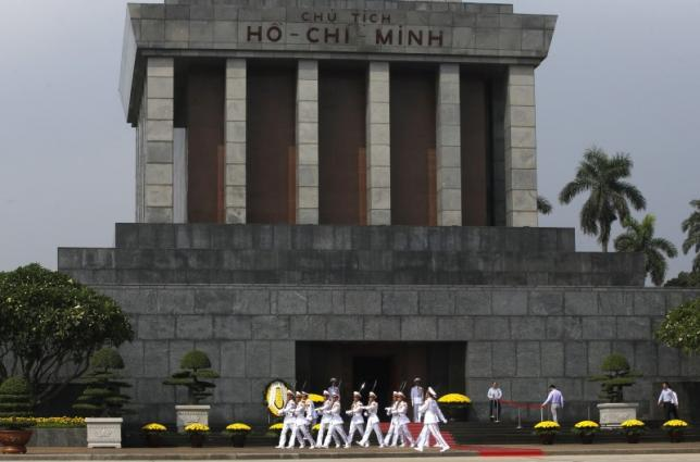 Soldiers leave after a wreath-laying ceremony attended by China's President Xi Jinping at the mausoleum of late Vietnamese revolutionary leader Ho Chi Minh in Hanoi, Vietnam