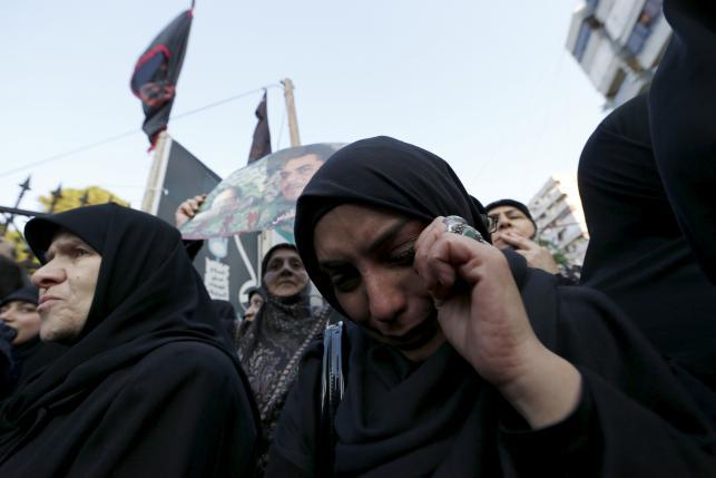 Women react during the funeral of Lebanese Hezbollah militant leader Samir Qantar in Beirut's southern suburbs