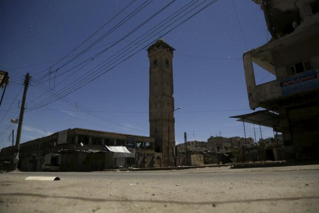 A damaged minaret is pictured at night in the rebel-controlled area of Maaret al-Numan town in Idlib province, Syria