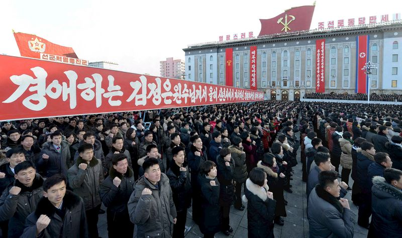 People take part in a mass rally at Kim Il Sung Square in Pyongyang