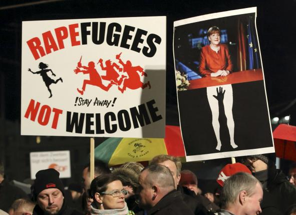 Members of LEGIDA, the Leipzig arm of the anti-Islam movement Patriotic Europeans Against the Islamisation of the West (PEGIDA) hold a placards in Leipzig