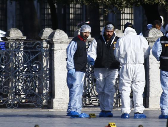 Police forensic officers attend scene after an explosion near the Ottoman-era Sultanahmet mosque in Istanbul