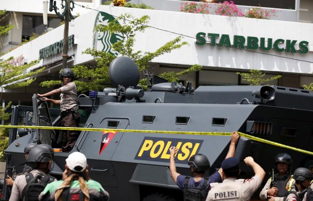 A police armoured personnel carrier is seen parked near the scene of an attack in central Jakarta