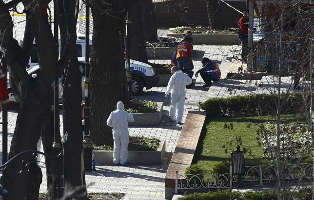 Police forensic experts work on the scene of an explosion in central Istanbu