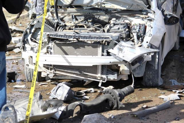 A wrecked vehicle is pictured at the scene of an explosion at the Police Training Centre in the town of Zliten