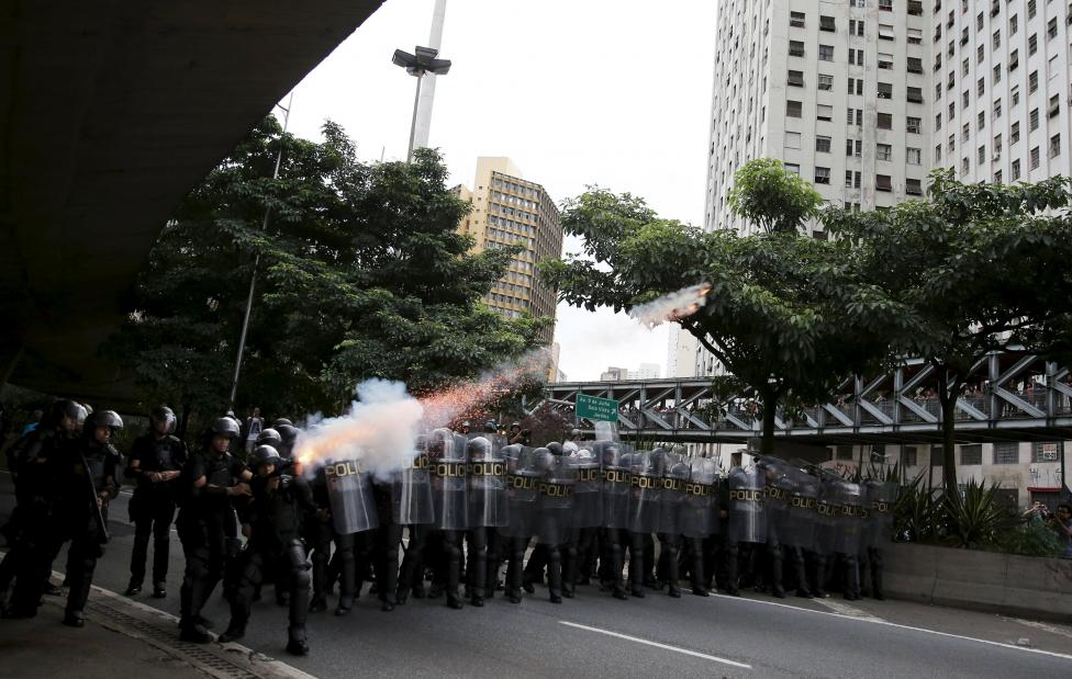 Riot police fire tear gas at demonstrators during a protest against fare hikes for city buses in Sao Paulo