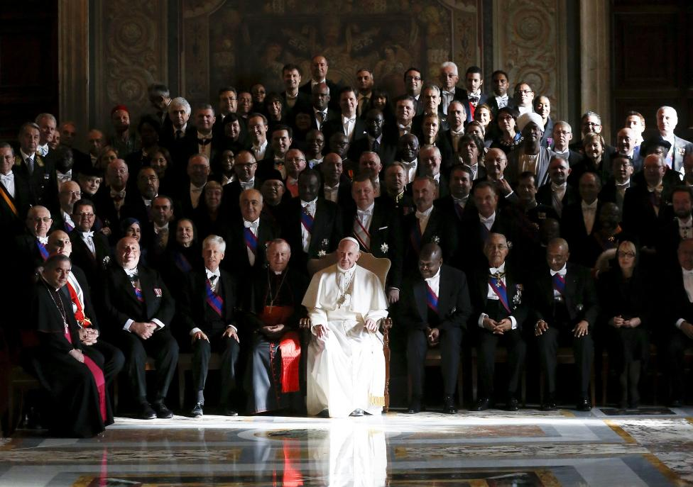 Pope Francis poses with ambassadors during an audience with the diplomatic corps at the Vatican