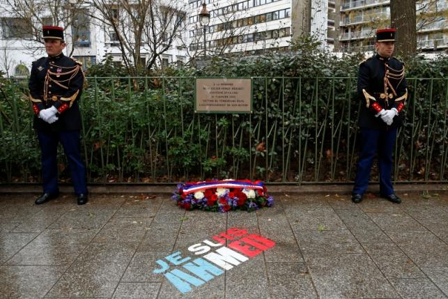 A commemorative plaque is seen during a ceremony at the site where policeman Ahmed Merabet was killed during the last year's January attack in Paris