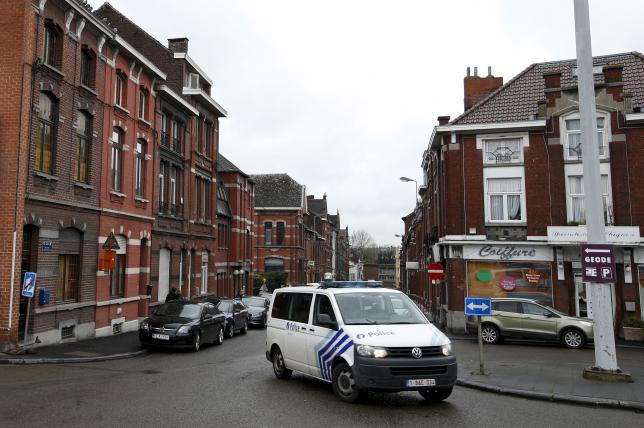 """A Belgian police van is pictured in a street called """"Rue du Fort"""" in Charleroi"""