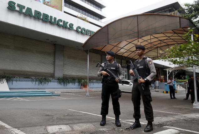 Indonesian police guard at the site of this week's militant attack in central Jakarta, Indonesia