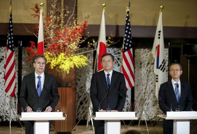 Japan's Vice Foreign Minister Saiki, U.S. Deputy Secretary of State Blinken, and South Korean First Vice Foreign Minister Lim attend a joint news conference during their trilateral meeting at the foreign ministry's Iikura guest house in Tokyo