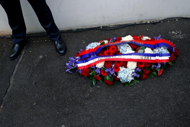 A wreath of flowers is seen during a ceremony to unveil a commemorative plaque to pay tribute to the victims of the last year's January attacks outside the former offices of French weekly satirical newspaper Charlie Hebdo in Paris