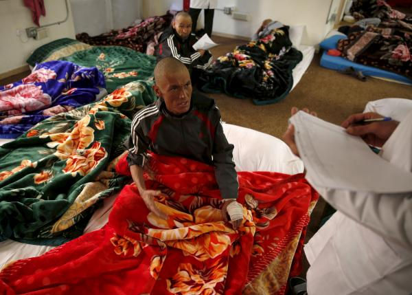 A drug addict speaks to a doctor at a newly-opened treatment centre at Camp Phoenix, in Kabul, Afghanistan