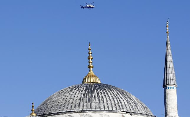 A police helicopter flies over the Ottoman-era Sultanahmet mosque, known as the Blue mosque, following an explosion nearby, in Istanbul, Turkey