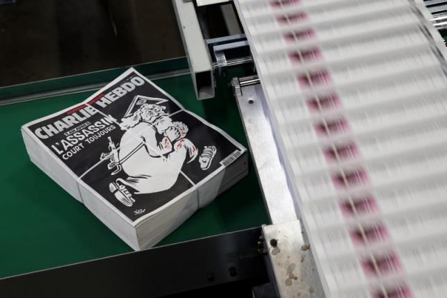 Packed copies of the latest edition of French weekly newspaper Charlie Hebdo are seen at a printing house near Paris
