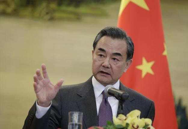 China's Foreign Minister Wang Yi speaks at a joint news conference in Beijing