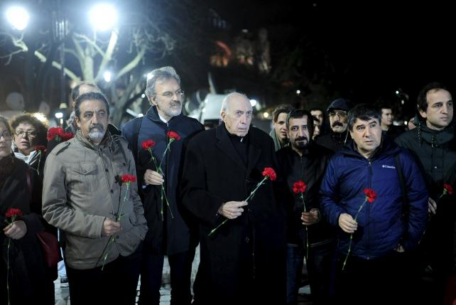Members of the Istanbul Medical Chamber hold carnations near the blast site at Sultanahmet square in Istanbul