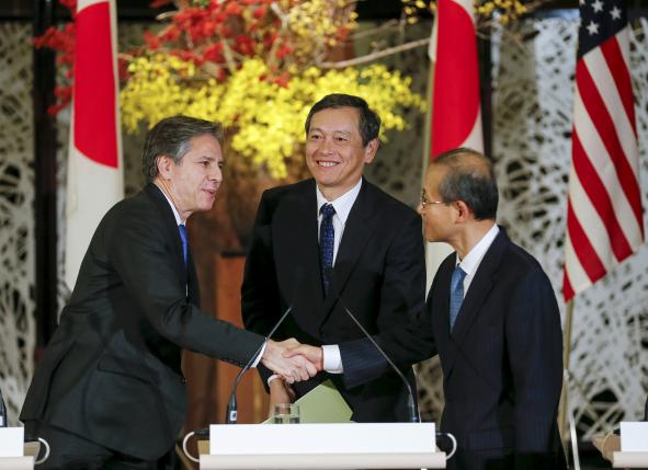 U.S. Deputy Secretary of State Blinken shakes hands with South Korean First Vice Foreign Minister Lim as they attend a joint news conference in Tokyo