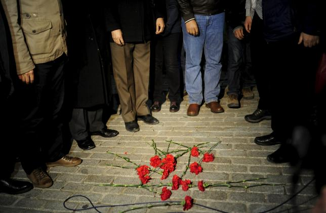 Members of the Istanbul Medical Chamber place carnations near the blast site at Sultanahmet square in Istanbul