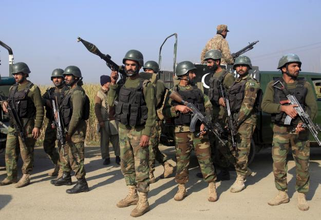 Soldiers gather outside Bacha Khan University where an attack by militants took place, in Charsadda, Pakistan