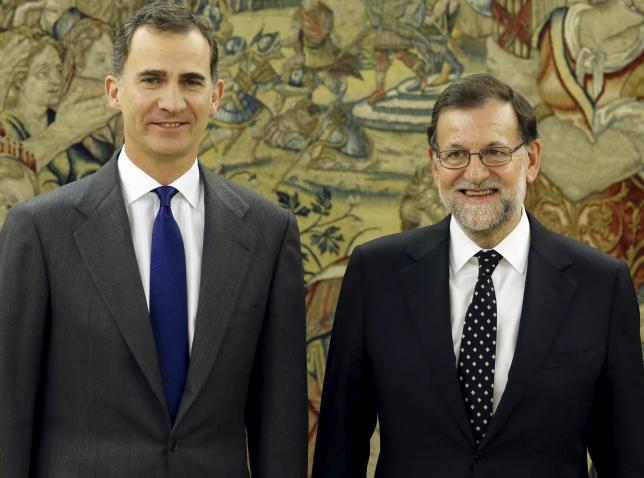 Spanish King Felipe and acting PM Rajoy pose before their meeting in Madrid