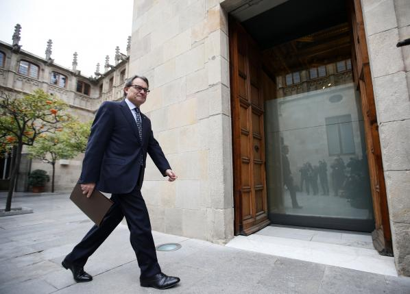 Catalan acting President Artur Mas arrives for a government meeting at Palau de la Generalitat in Barcelona