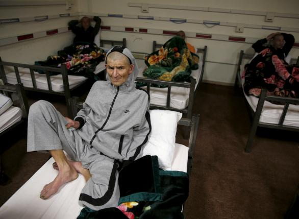 A drug addict sits on his bed at a newly-opened treatment centre at Camp Phoenix, in Kabul, Afghanistan