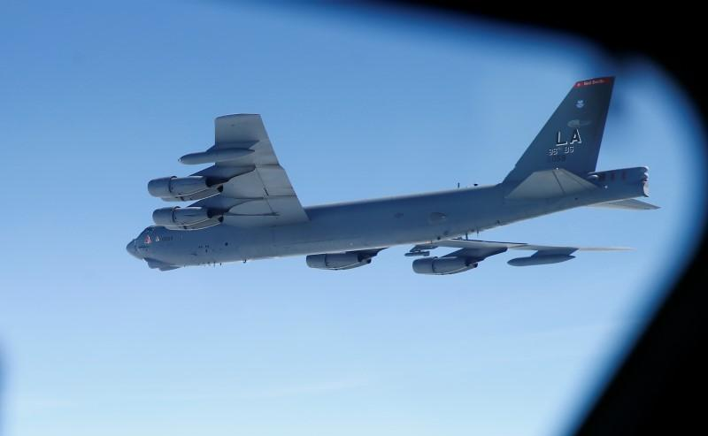 A U.S. Air Force B-52 is seen through the window of another during a training mission in the United Kingdom's airspace