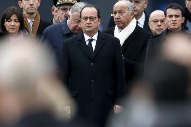 French President Francois Hollande attends a ceremony at Place de la Republique square to pay tribute to the victims of last year's shooting at the French satirical newspaper Charlie Hebdo, in Paris