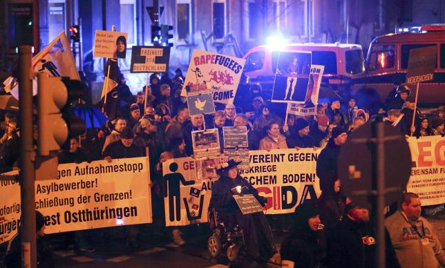 Members of LEGIDA, the Leipzig arm of the anti-Islam movement PEGIDA, take part in a rally in Leipzig