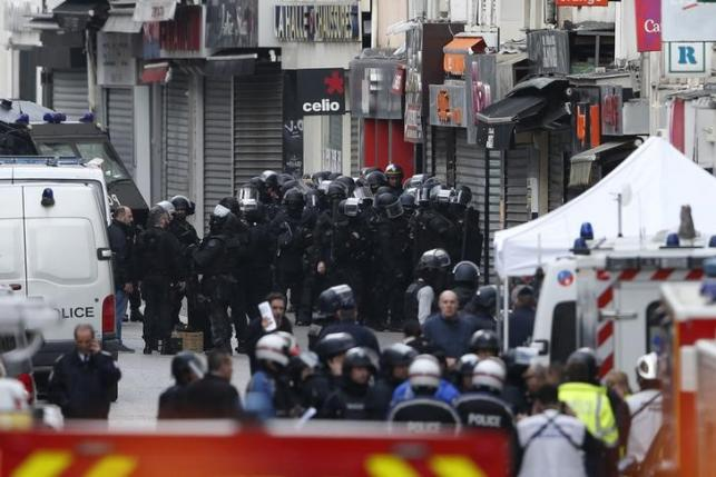 Members of French special RAID forces gather on the scene in Saint-Denis